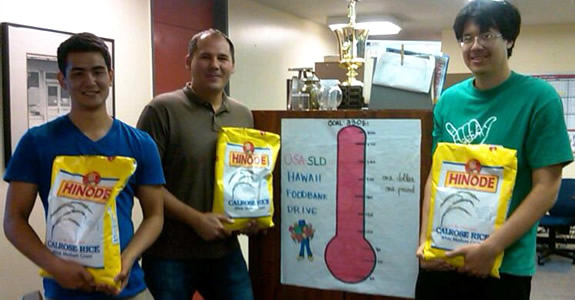 SLD's goal in the 2013 Foodbank Drive: (left to right) Student Asst. Erik Kinne, Student Life Services Associate James Frizzell and Student Asst. Martin Deabler